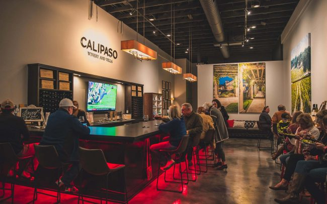 CaliPaso Winery and Villa Tasting Room with bar under-lit with red lights