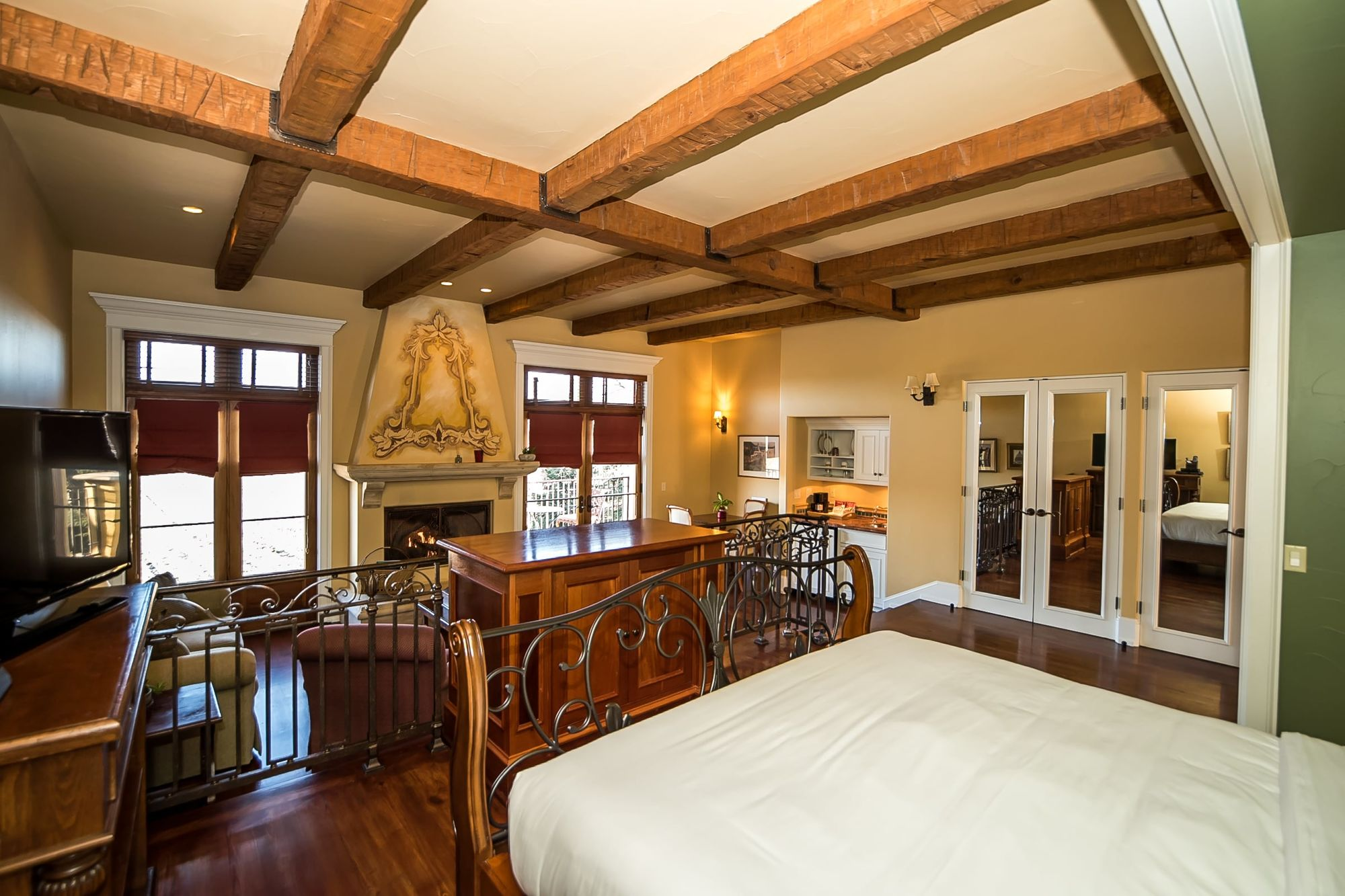 Room with rafters on the ceiling and fireplace with decorative chimney breast