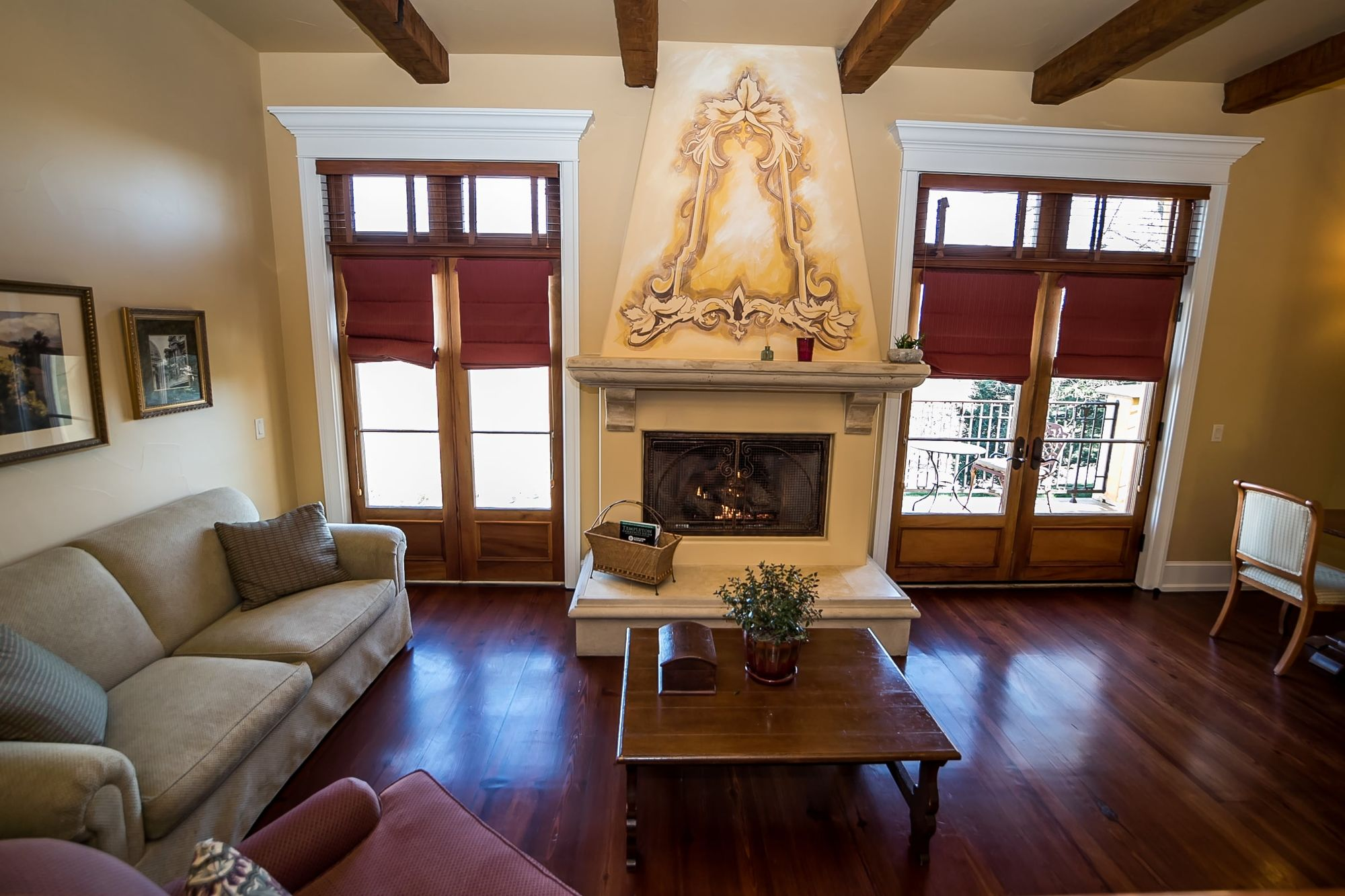 Sitting area with fireplace and decorative chimney breast and french doors on either side
