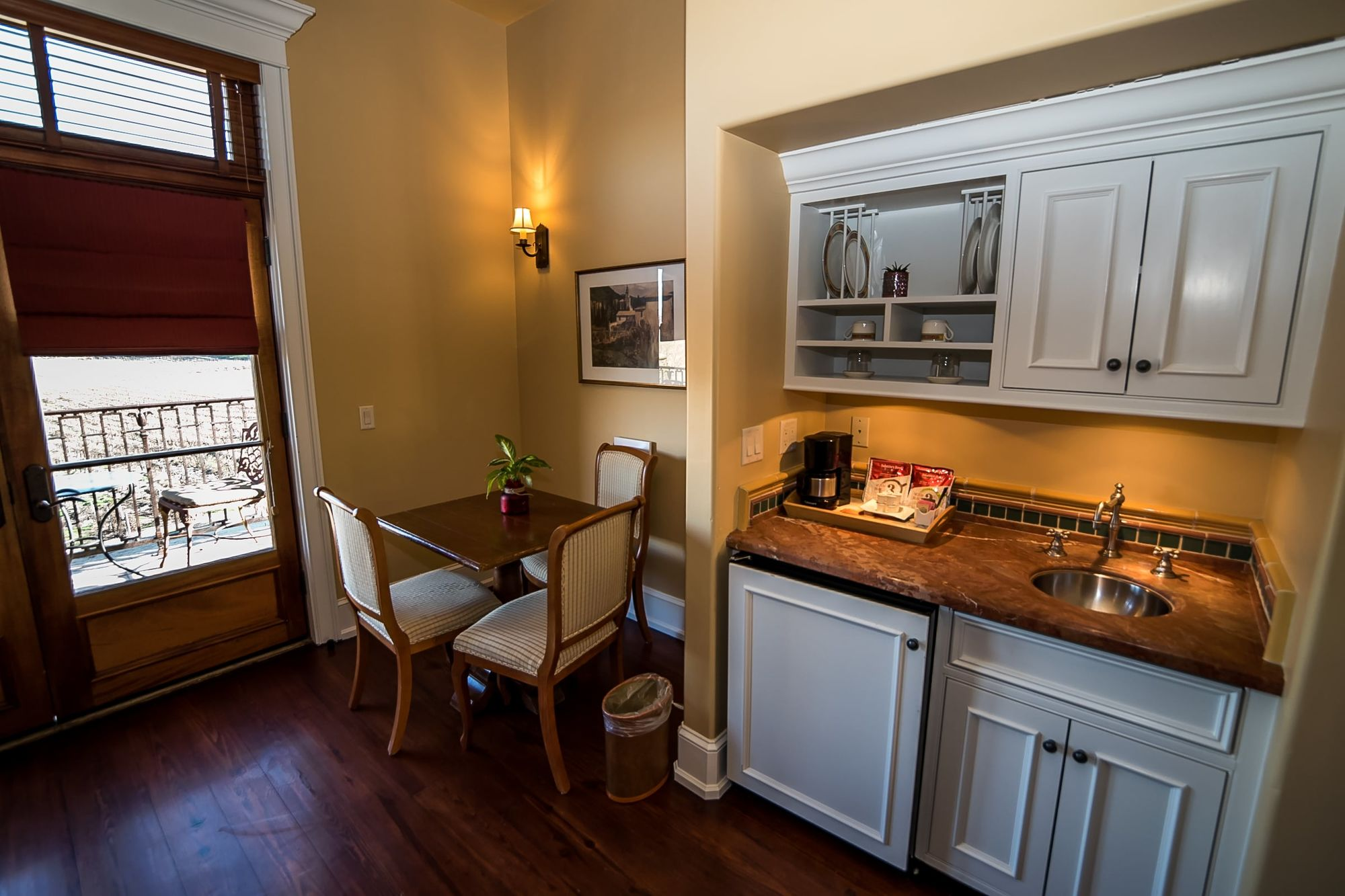 Small wet bar with seating area for three