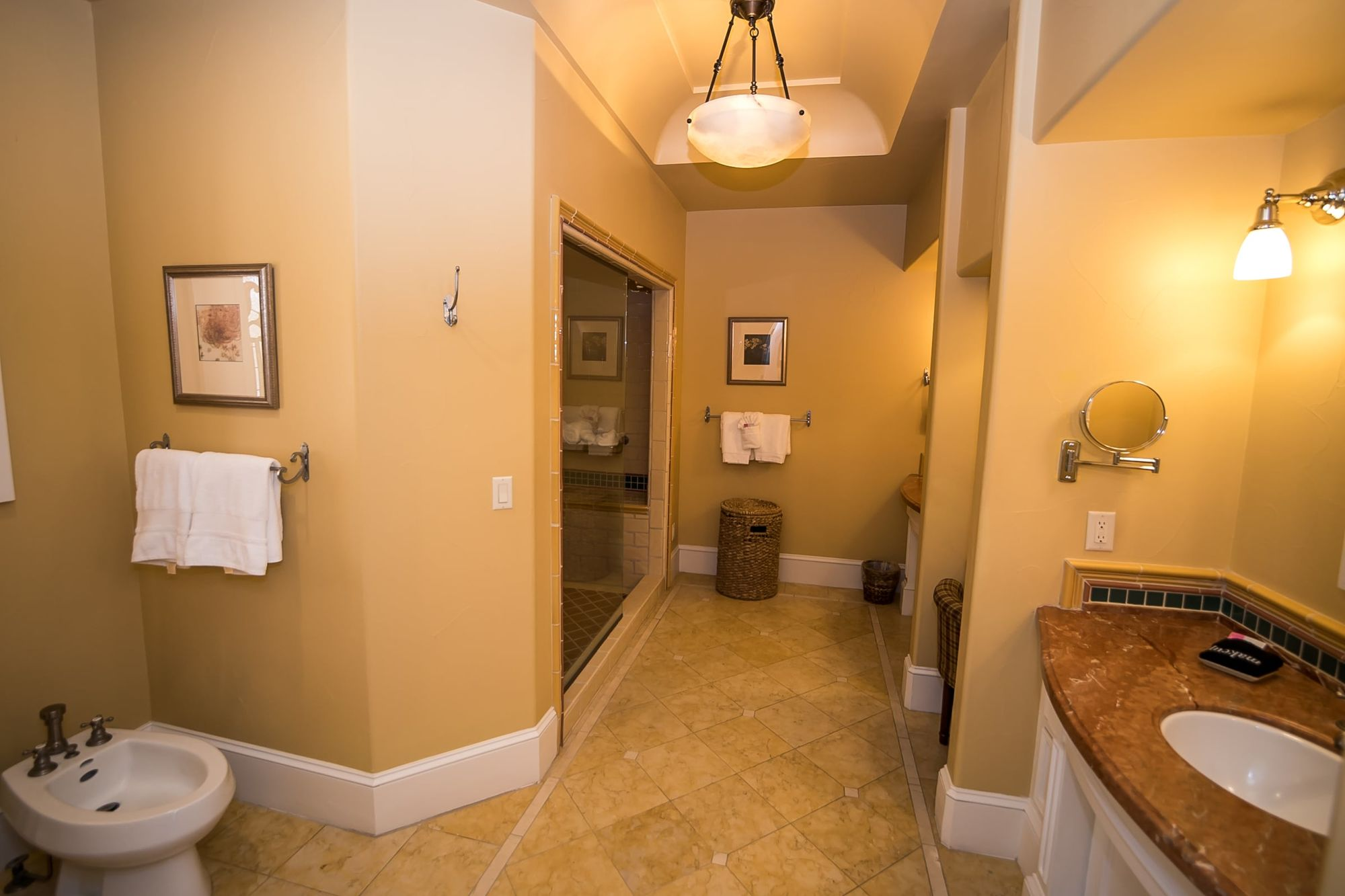 Bathroom with bidet to left and vanity to the right