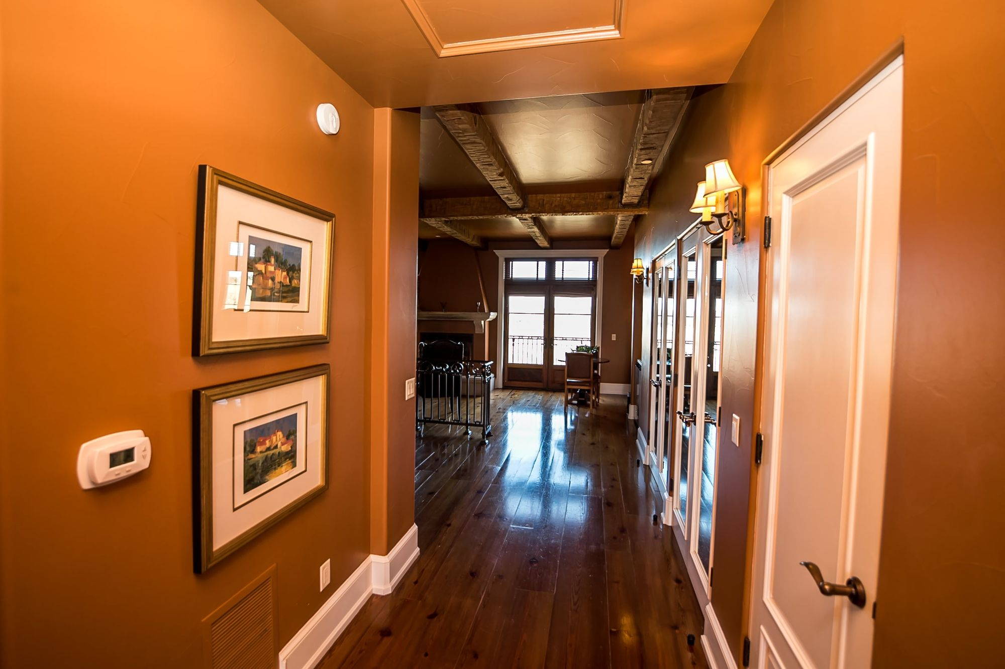 Hallway with French doors at the end