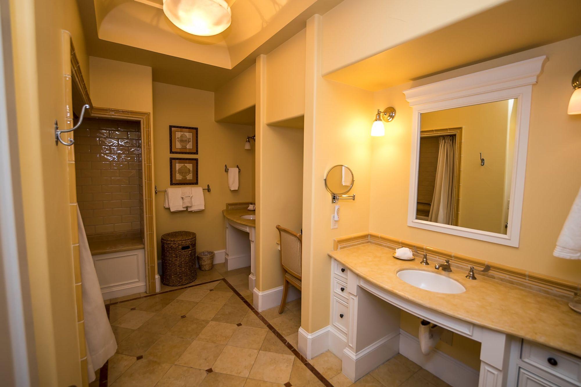 Bathroom with two vanities and tile floors