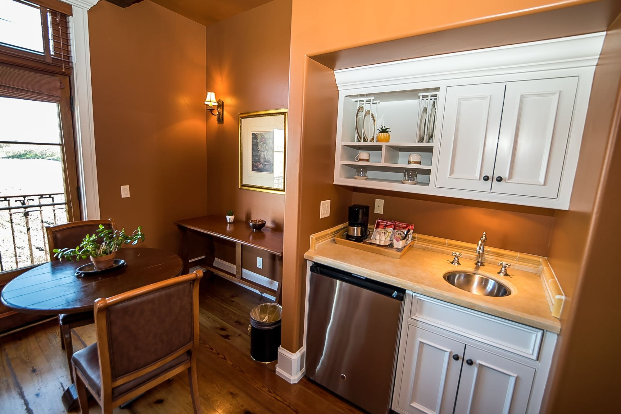 Small wet bar with table and seating for two