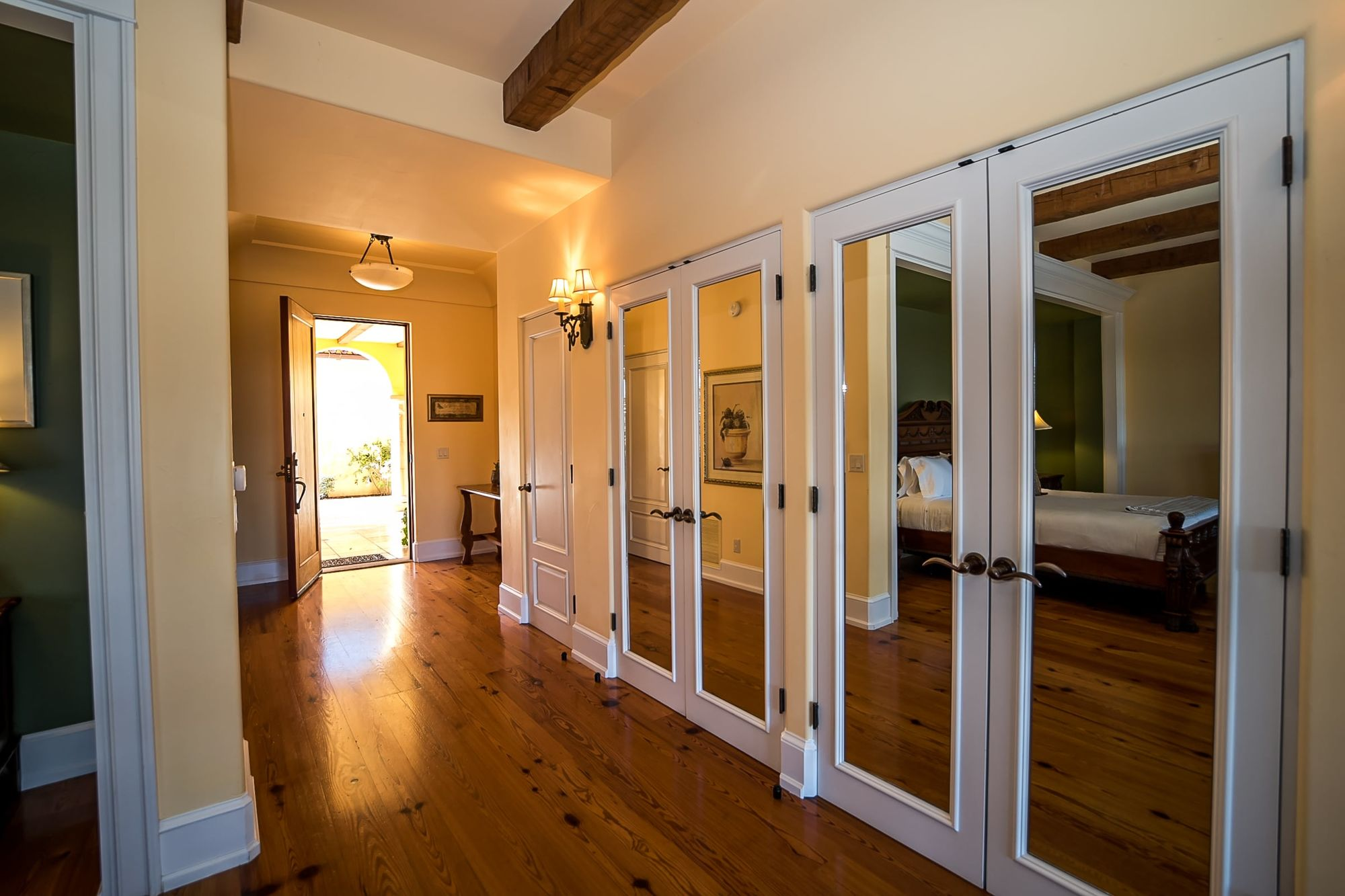 Hallway with doors inset with mirrors