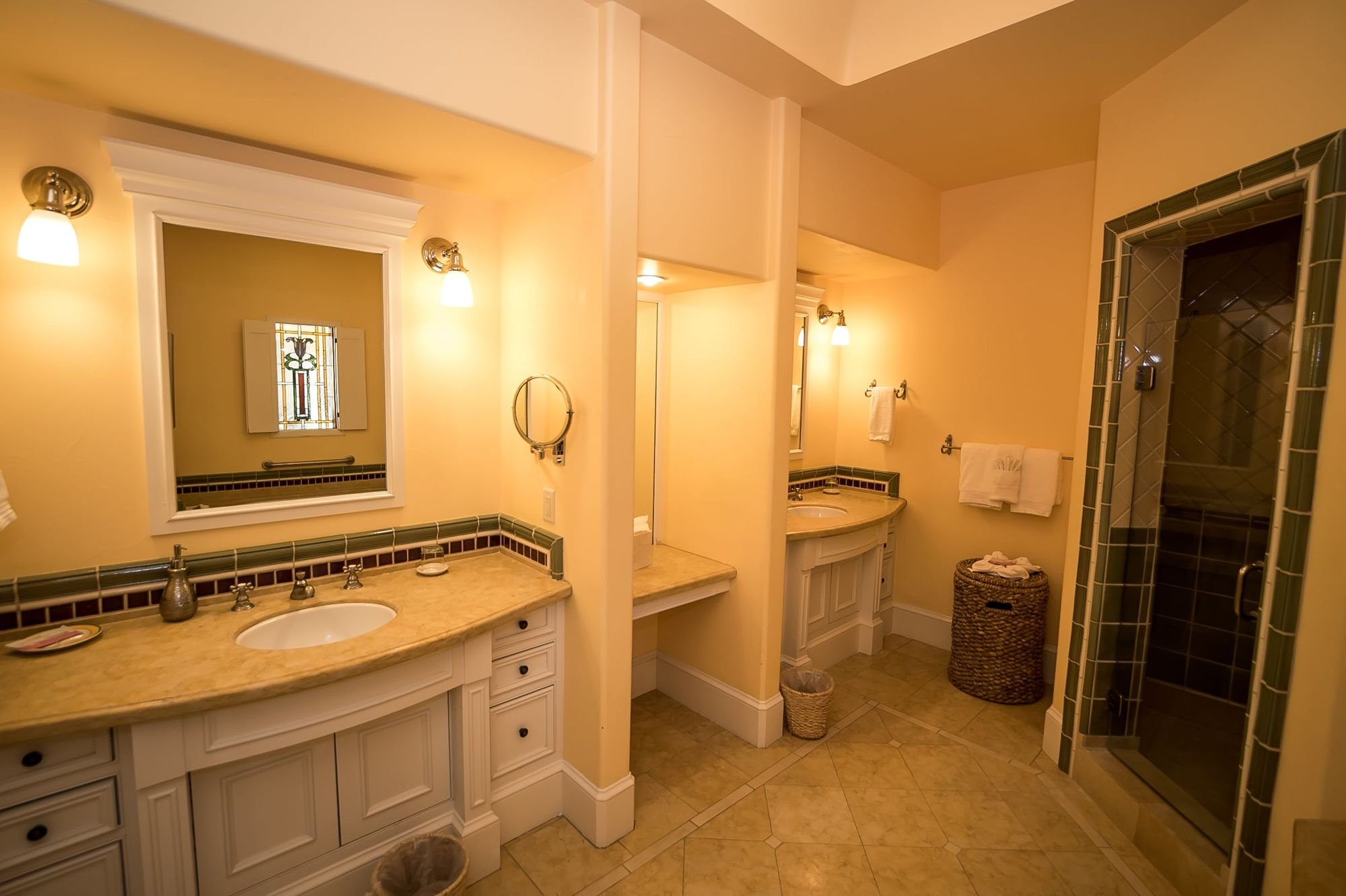 Bathroom with two vanities and walk-in shower