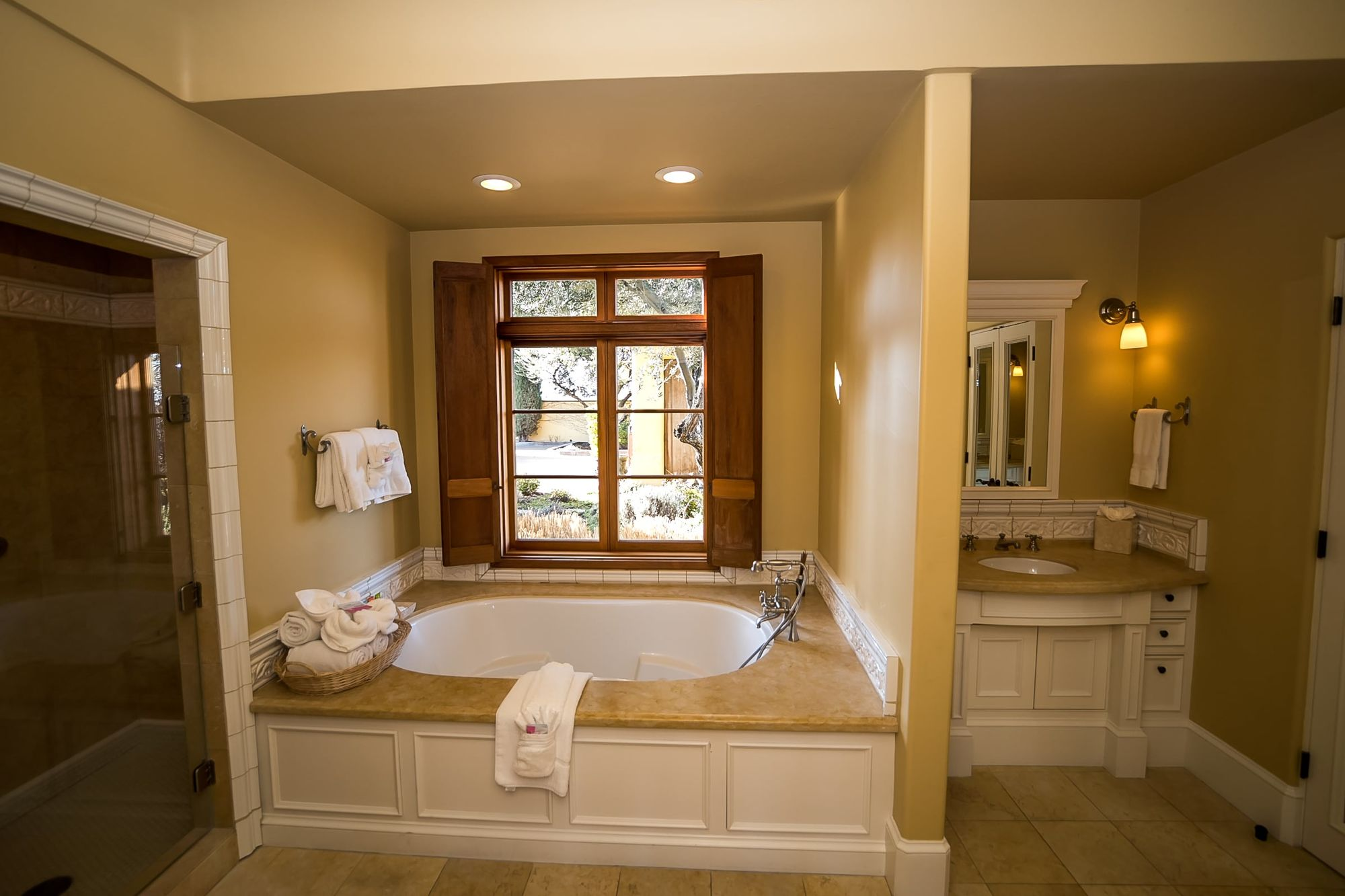 Bathroom with spa tub and towels in a basket with a vanity to the left